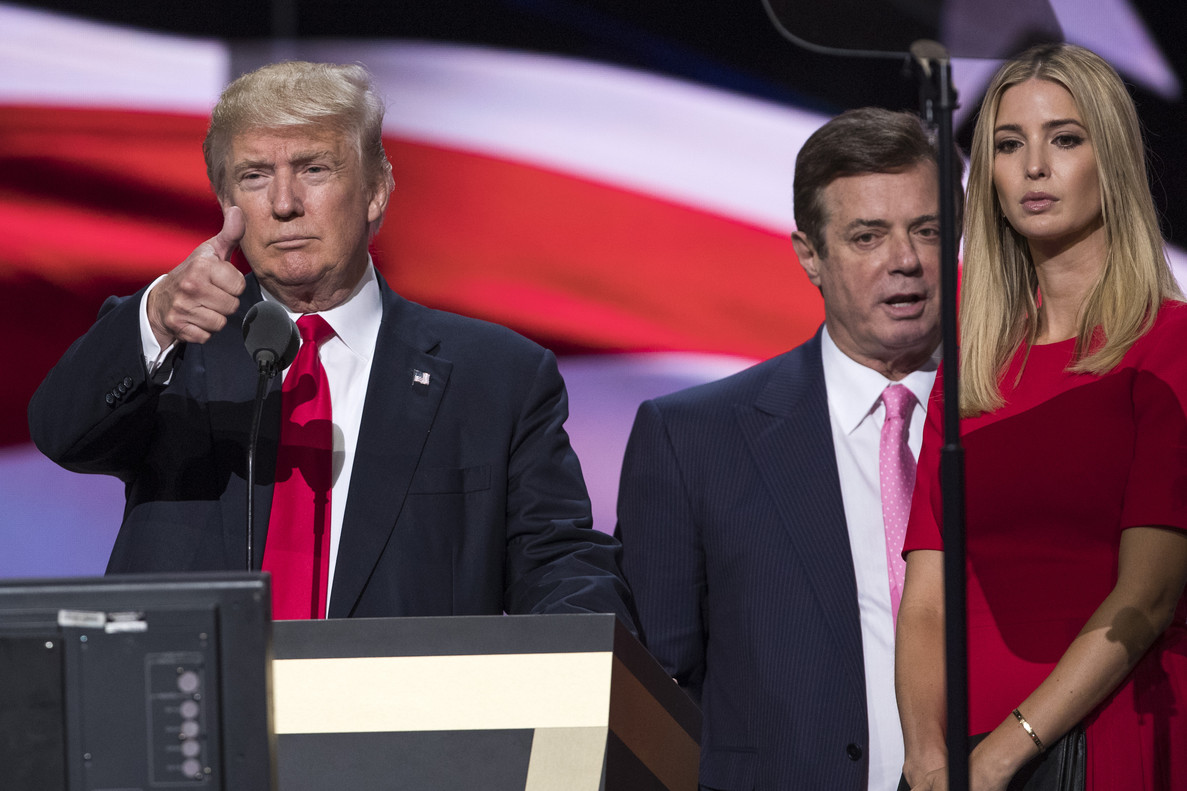 FILE - In this July 21, 2016 file photo, then-Trump Campaign manager Paul Manafort stands between the then-Republican presidential candidate Donald Trump and his daughter Ivanka Trump during a walk through at the Republican National Convention in Cleveland. Oleg Deripaska, a Russian billionaire close to President Vladimir Putin says he is willing to take part in U.S. congressional hearings to discuss his relationship with President Donald Trumpâ¿¿s former campaign chairman, Paul Manafort. (AP Photo/Evan Vucci, File)