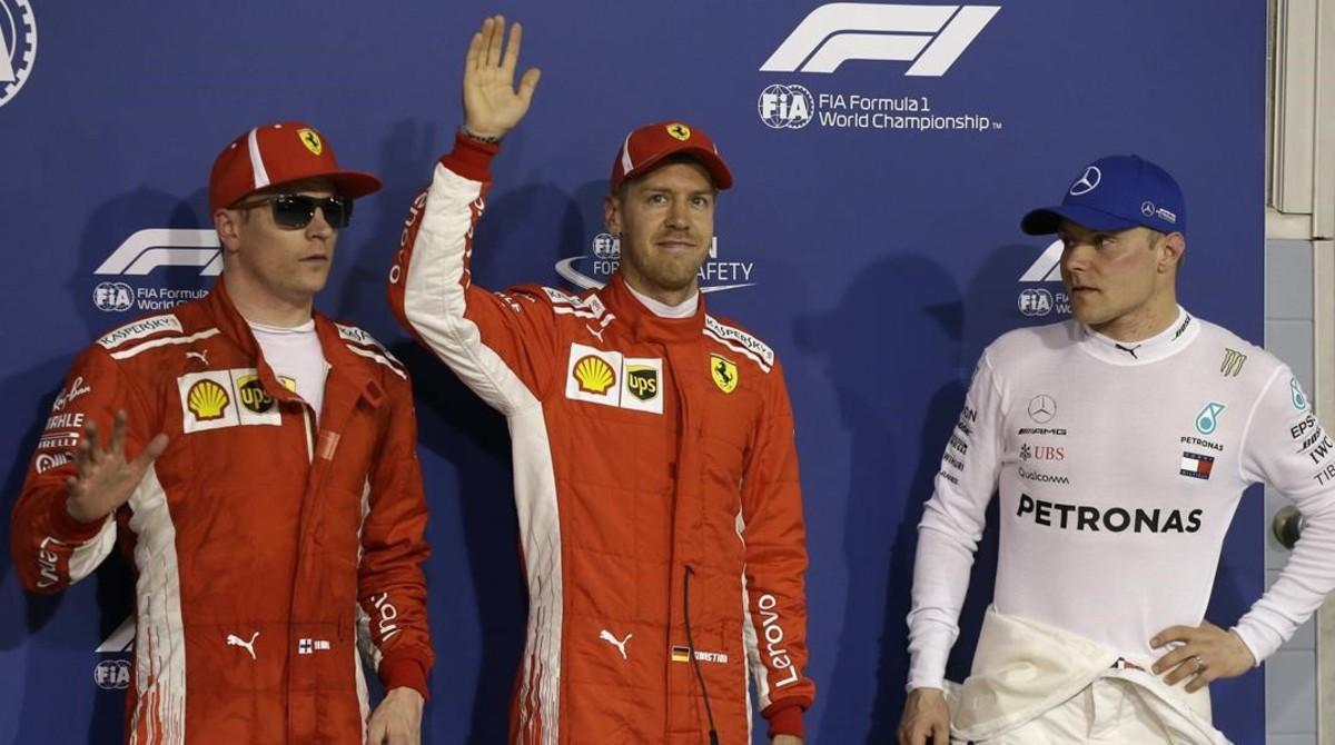 Kimi Raikkonen, Sebastian Vettel y Valttweri Bottas, en el podio del sábado de Baréin.