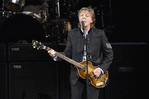 Paul McCartney performs on the One on One Tour at the Hollywood Casino Amphitheatre in Tinley Park  Ill  Commuters with tickets to ride out of New York s Grand Central Station heard a special serenade with McCartney taking over a corner of the majestic hub for a concert  It was a stunt to promote a new album called  Egypt Station    Photo by Rob Grabowski Invision AP  File