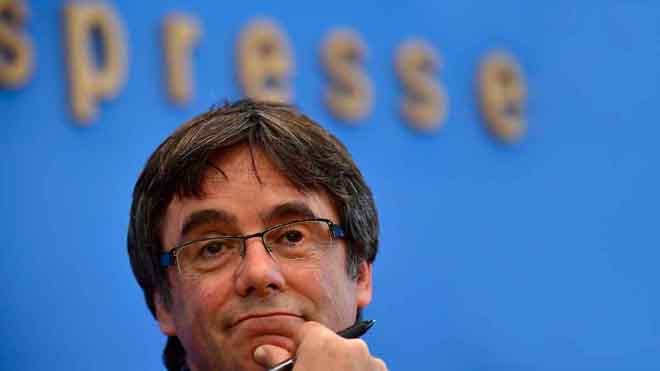"Puigdemont: ""No tardaré 20 anys a tornar a trepitjar terra català"""