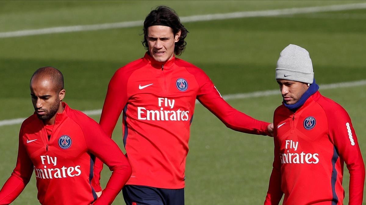 Moura, Cavani y Neymar, en el entrenamiento de este jueves del PSG.
