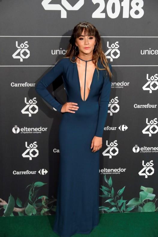 Aitana posando en el photocall de la cena de nominados de Los 40 Music Awards.