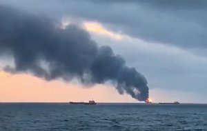 An image grab taken from AFP TV shows a burning ship after a fire engulfed at two gas tankers in the Black Sea off Crimea  Photo by  AFPTV   AFP
