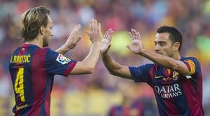 Xavi i Rakitic, en un partit al Camp Nou.