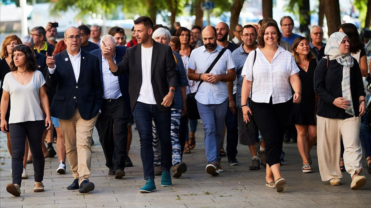 Los ediles acusados, llegando a la Ciutat de la Justícia el día del juicio.