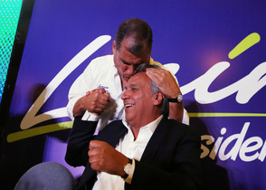 Ecuadors President Rafael Correa kisses Lenin Moreno, candidate of the ruling PAIS Alliance Party, at the Hotel Colon during the presidential election in Quito
