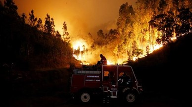 abertran38938774 firefighters work to put out a forest fire near bouca in ce170618115756