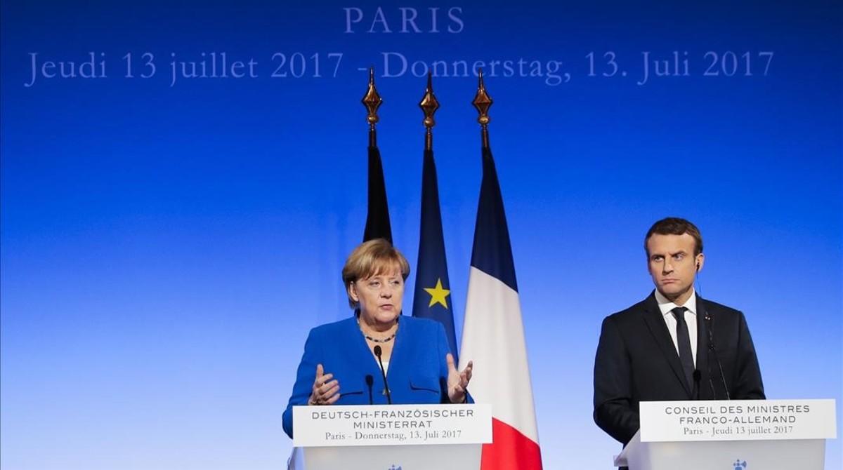 La cancillera alemana Angela Merkel y el presidente de Francia Emmanuel Macron.