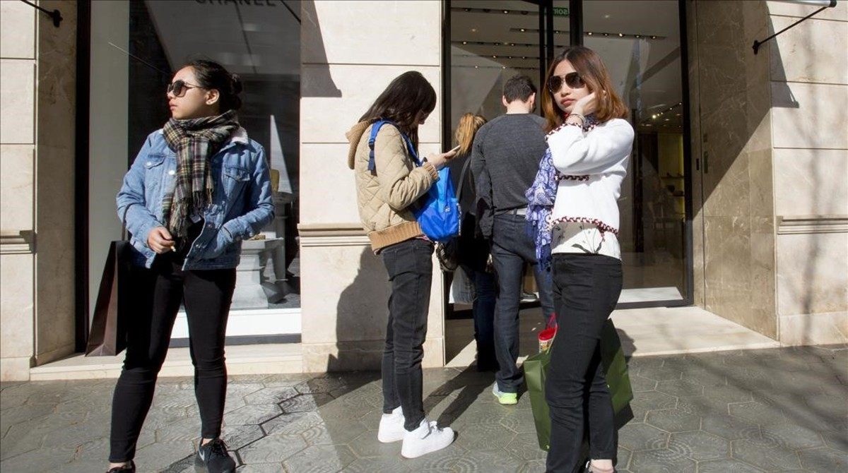 Turistas chinasen Barcelona.
