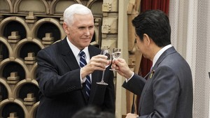 undefined41939865 u s vice president mike pence left cheers during a courte180207110354