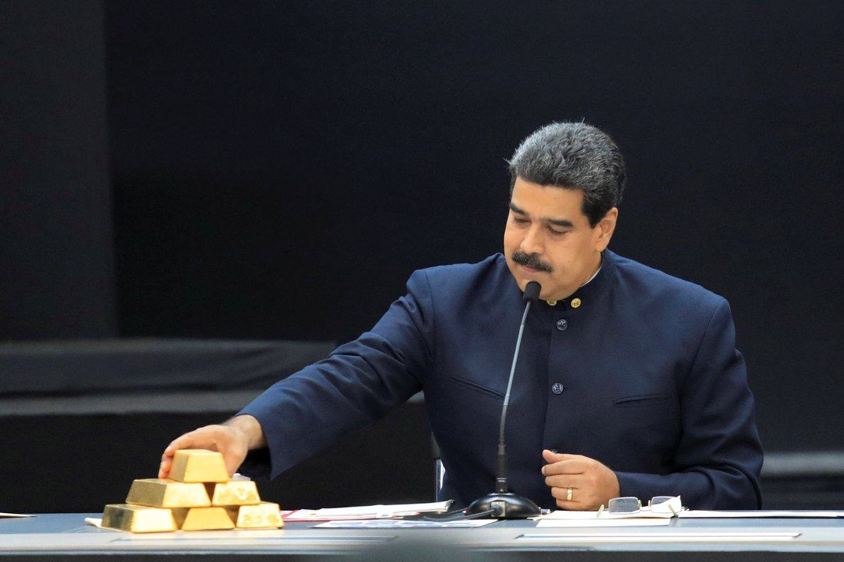 Venezuela s President Nicolas Maduro touches a gold bar as he speaks during a meeting with the ministers responsible for the economic sector at Miraflores Palace in Caracas   REUTERS Marco Bello File Photo
