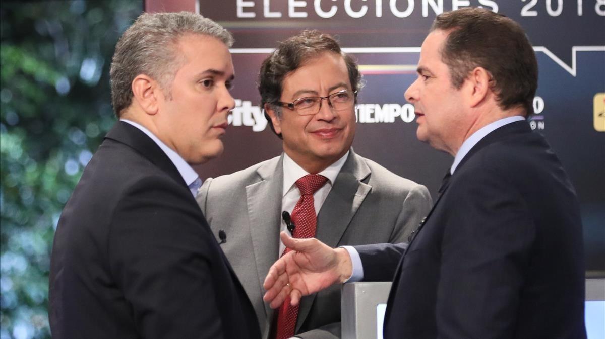 Los candidatos a la presidencia de Colombia: Gustavo Petro (centro), Iván Duque (izquierda)y German Vargas Lleras (derecha), en un debate de televisión.