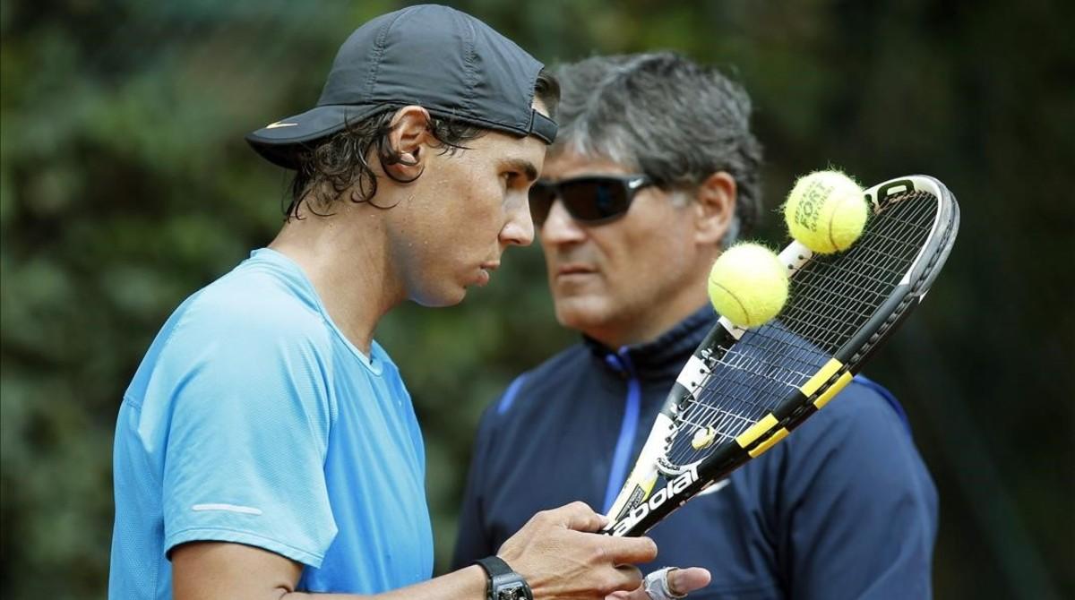 Rafael Nadal y su tío y entrenador, Toni Nadal, durante un entrenamiento en Madrid.