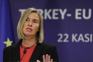 The European Union s foreign policy chief Federica Mogherini speaks during a joint news conference with Turkish Foreign Minister Mevlut Cavusoglu and EU Enlargement Commissioner Johannes Hahn after their meeting  in Ankara  Turkey. AP Photo Burhan Ozbilici