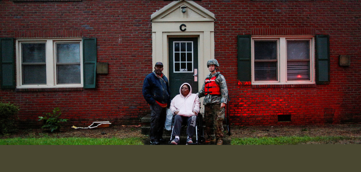A woman in a wheelchair and attached to a respiratory system is rescued by members of the U.S. Army during the passing of Hurricane Florence in the town of New Berg, North Carolina, U.S., September 14, 2018. REUTERS/Eduardo Munoz