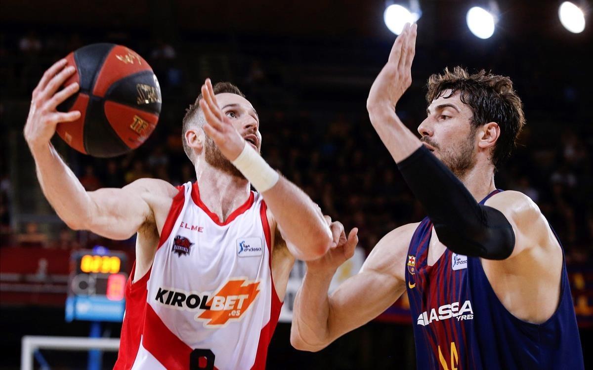 Duelo en los playoff de la ACB: Tomic, del Barça, y Huertas, del Baskonia.