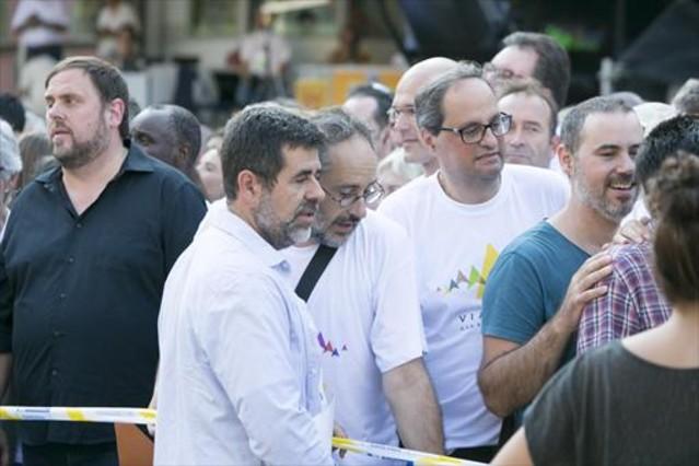Jordi Sànchez, a Antonio Baños y Quim Torra, en la Via Lliure de la Diada del 2015.