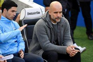 Pep Guardiola, técnico del City, junto a Arteta