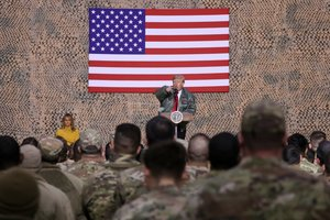 U.S. President Donald Trump, with first lady Melania Trump, delivers remarks to U.S. troops in an unannounced visit to Al Asad Air Base, Iraq. REUTERS/Jonathan Ernst