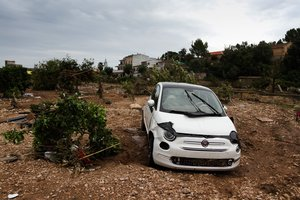 A car on a destroyed crop after flooding in Sant Llorenc  60 kilometers  40 miles  east of Mallorca s capital  Palma  Spain  Wednesday  Oct  10  2018  Torrential rainstorms that caused flash flooding of water and mud on the Spanish island of Mallorca killed at least nine people  authorities said on Wednesday   AP Photo Francisco Ubilla