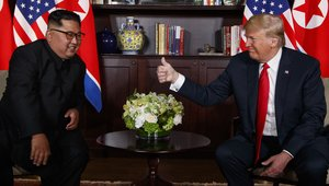 FILE - In this June 12 2018 file photo U S President Donald Trump right meets with North Korean leader Kim Jong Un on Sentosa Island in Singapore Trumpa s message to North Korea has been simple and clear give up your nuclear weapons and a flood of wealth will soon be yours for the taking AP Photo Evan Vucci File