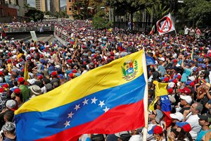 FILE PHOTO Opposition supporters take part in a rally against Venezuelan President Nicolas Maduro s government and to commemorate the 61st anniversary of the end of the dictatorship of Marcos Perez Jimenez in Caracas Venezuela January 23 2019 REUTERS Carlos Garcia Rawlins File Photo