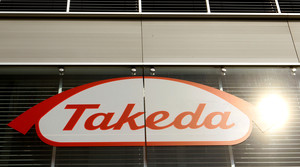 FILE PHOTO: The logo of Japanese Takeda Pharmaceutical Co is seen at an office building in Glattbrugg near Zurich March 7, 2012. REUTERS/Arnd Wiegmann/File Photo