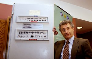 LOA05D:INTERNET:LOS ANGELES,CALIFORNIA,2SEP99 - Dr. Leonard Kleinrock, professor of computer science at UCLA poses with the Interface Message Processor at the 30th anniversary of the Internet symposium September 2 at UCLA in Los Angeles. The processor was used 30 years at the creation of the Internet. Kleinrock is known as the inventor of the Internet Technology. The birth of the Internet occurred when Kleinrock's Host computer at UCLA became the first node of the Internet in September 1969. fsp/Photo by Fred Prouser REUTERS