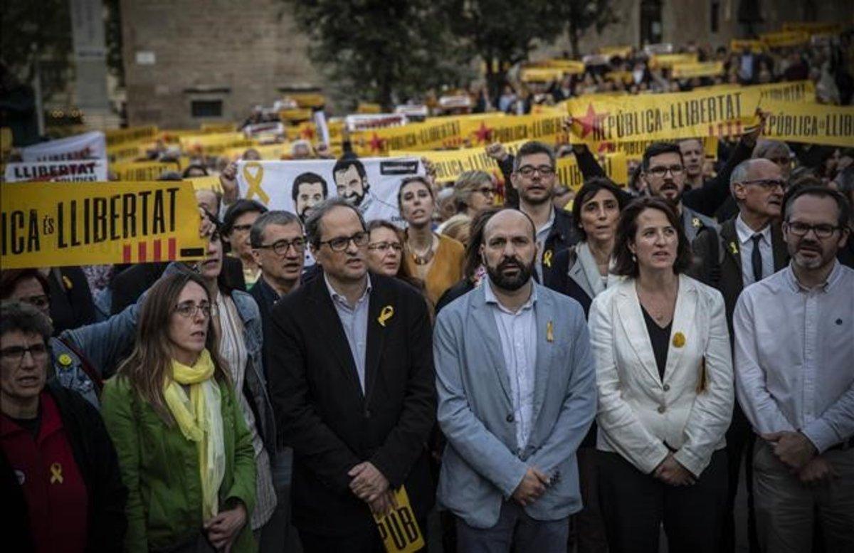 El 'president' de la Generalitat, Quim Torra, junto a la líder de la ANC, Elisenda Paluzie, y el vicepresidente de Òmnium Cultural, Marcel Mauri.