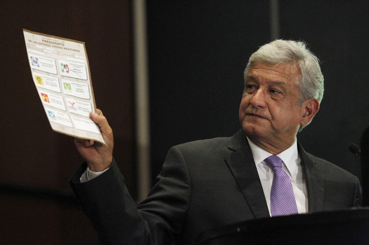 Andres Manuel Lopez Obrador presidential candidate for the Party of the Democratic Revolution PRD shows a ballot during a news conference in Mexico city July 12 2012 The runner-up in Mexico s presidential election said on Thursday he will ask the country s electoral tribunal to void the results arguing that the winner broke campaign finance laws to buy votes Lopez Obrador came in 3 3 million votes behind Enrique Pena Nieto from the centrist Institutional Revolutionary Party PRI according to the official count from the July 1 vote REUTERS Edgard Garrido MEXICO - Tags POLITICS ELECTIONS