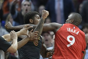 Mar 11, 2019; Cleveland, OH, USA; Cleveland Cavaliers forward Marquese Chriss (3) and Toronto Raptors center Serge Ibaka (9) throw punches in the third quarter at Quicken Loans Arena. Both players were ejected. Mandatory Credit: David Richard-USA TODAY Sports