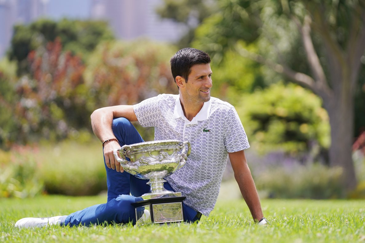 Novak Djokovic of Serbia poses for a portrait at Royal Botanic Gardens Victoria in Melbourne, Monday, February 3, 2020. Novak Djokovic has celebrated his eighth championship title after winning the men's singles final at the Australian Open tennis tournament. (AAP Image/Michael Dodge) NO ARCHIVING