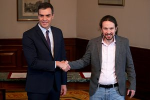 Spanish acting Prime Minister Pedro Sanchez and Unidas Podemos (Together We Can) leader Pablo Iglesias shake hands during a news conference at Spain's Parliament in Madrid, Spain, November 12, 2019. REUTERS/Sergio Perez