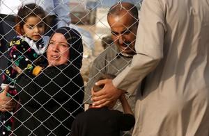 Un grupo de refugiados iraquís que han salido de Mosul.