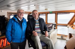 13/06/2019 13 June 2019, Iceland, Reykjavik: German President Frank-Walter Steinmeier (L) and Gudni Thorlacius Johannesson President of Iceland, take a ferry to Heimaey Island on the Westman Islands. Steinmeier and his wife are on a two-day state visit to Iceland. Photo: Bernd von Jutrczenka/dpa