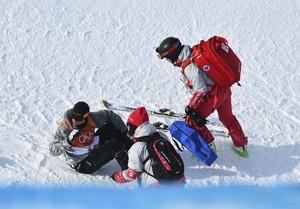 Freestyle Skiing - Pyeongchang 2018 Winter Olympics - Men's Ski Halfpipe Qualifications - Phoenix Snow Park - Pyeongchang, South Korea - February 20, 2018 - Officials tend to Joel Gisler of Switzerland after his crash. REUTERS/Dylan Martinez