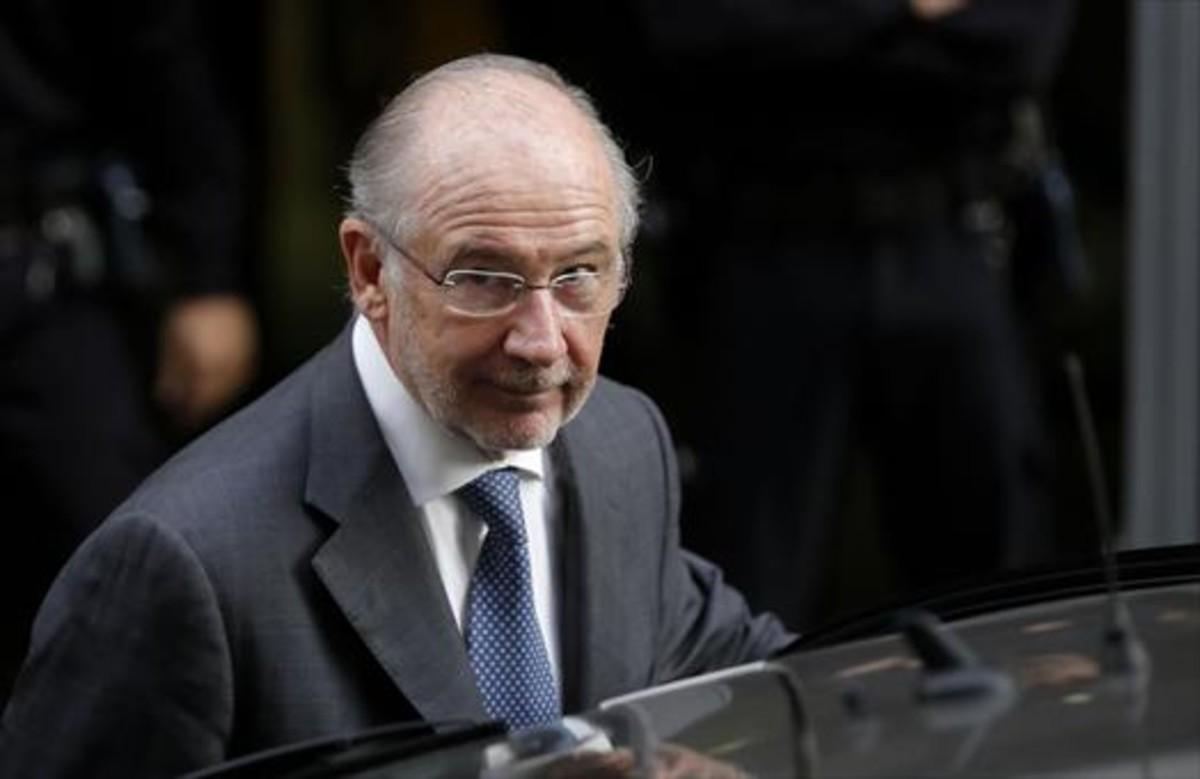 Rodrigo Rato sale de declarar en la Audiencia Nacional por el caso de las tarjetas opacas de Caja Madrid, en octubre del 2014.