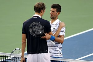MASON, OHIO - AUGUST 17: Daniil Medvedev of Russia (L) shakes hands with Novak Djokovic of Serbia after defeating him in three sets during Day 8 of the Western and Southern Open at Lindner Family Tennis Center on August 17, 2019 in Mason, Ohio. Rob Carr/Getty Images/AFP