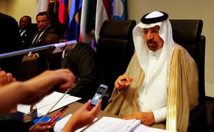 Saudi Arabias Energy Minister al-Falih talks to journalists before an OPEC meeting in Vienna