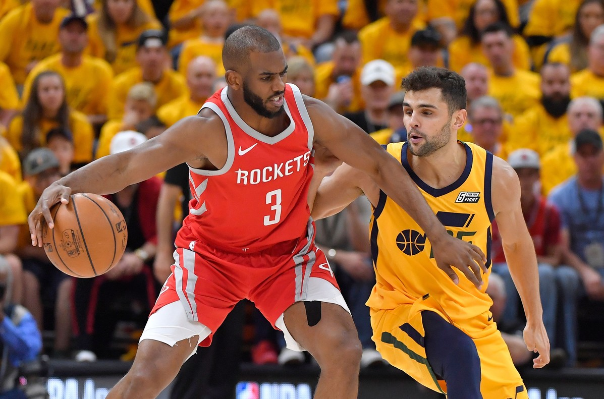 SALT LAKE CITY, UT - MAY 06: Chris Paul #3 of the Houston Rockets controls the ball in front of Raul Neto #25 of the Utah Jazz in the first half during Game Four of Round Two of the 2018 NBA Playoffs at Vivint Smart Home Arena on May 6, 2018 in Salt Lake City, Utah. NOTE TO USER: User expressly acknowledges and agrees that, by downloading and or using this photograph, User is consenting to the terms and conditions of the Getty Images License Agreement. Gene Sweeney Jr./Getty Images/AFP