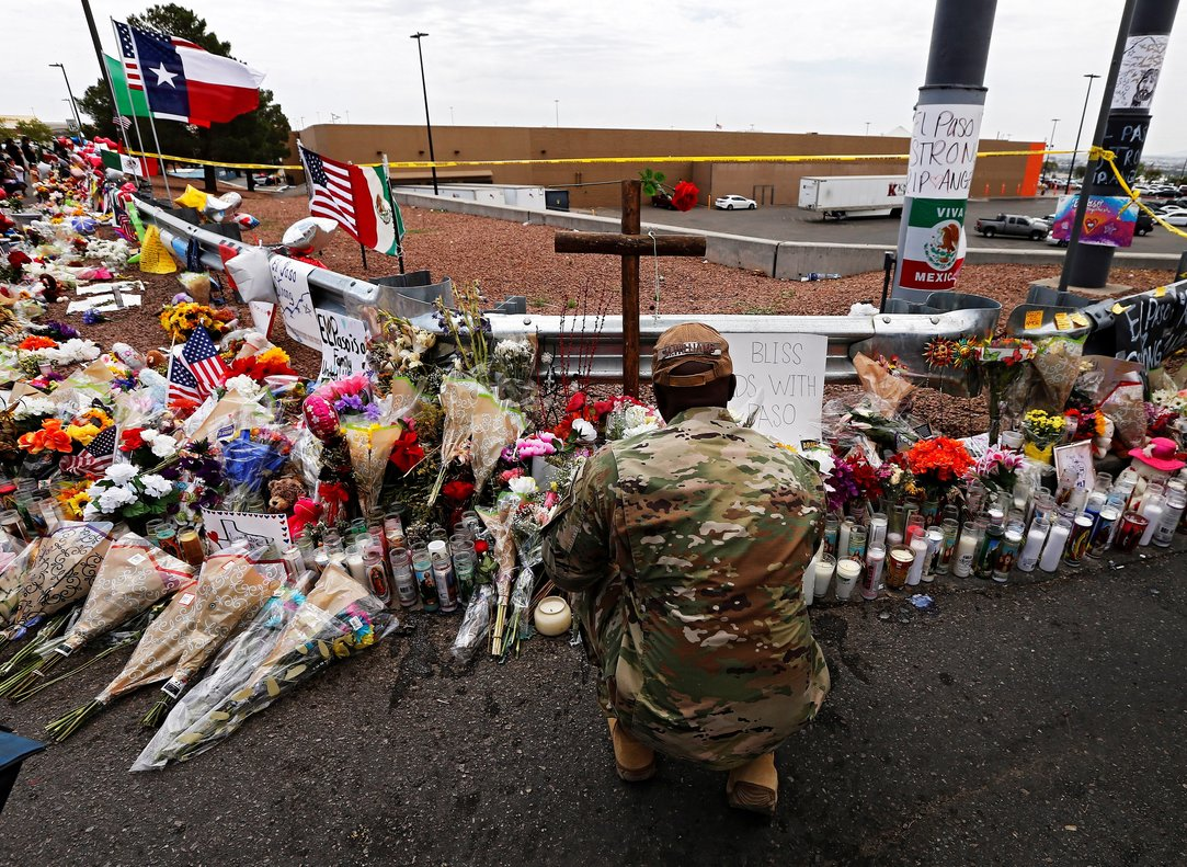 El Paso United States 06 08 2019 - A member of the military kneels down to lay flowers at the make shift memorial after the mass shooting that happened at a Walmart in El Paso Texas 06 August 2019 Twenty two people were killed and 26 injured during a mass shooting at the Walmart on 03 August 2019 Prosecutors said they will seek the death penalty against Patrick Crusius a 21-year-old man accused of the mass shooting Estados Unidos EFE EPA LARRY W SMITH