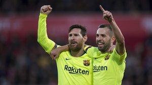 Messi y Alba celebran un gol ante el Girona.