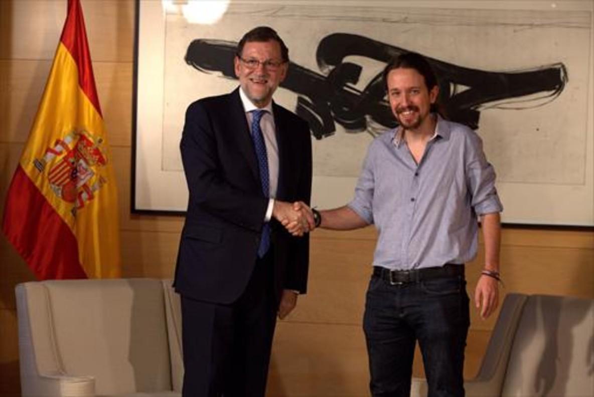 Rajoy e Iglesias, antes de reunirse en el Congreso en julio del pasado año.