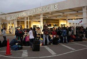 Inmigrantes venezolanos en la frontera de Chile.