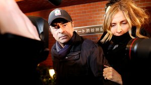 FILE PHOTO: Former Nissan Motor Chairman Carlos Ghosn accompanied by his wife Carole Ghosn, arrives at his place of residence in Tokyo, Japan, March 8, 2019. REUTERS/Issei Kato/File Photo