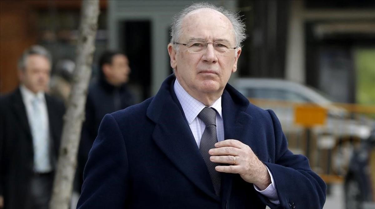 Rato, a su llegada a la Audiencia Nacional, imputado en varias causas.