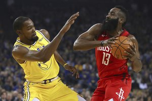 Golden State Warriors' Kevin Durant, left, defends against Houston Rockets' James Harden during the first half of an NBA basketball game Thursday, Jan. 3, 2019, in Oakland, Calif. (AP Photo/Ben Margot)