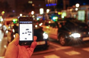 zentauroepp28083068 the uber app is seen on a smartphone past cabs passing on pa170607185755