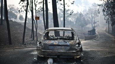 abertran38939680 a picture taken on june 18 2017 shows a burnt car on a road170618123053