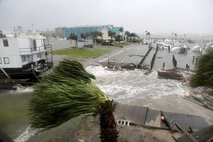 Boats lay sunk and damaged at the Port St  Joe Marina  Wednesday  Oct  10  2018 in Port St  Joe  Fla  Supercharged by abnormally warm waters in the Gulf of Mexico  Hurricane Michael slammed into the Florida Panhandle with terrifying winds of 155 mph Wednesday  splintering homes and submerging neighborhoods   Douglas R  Clifford Tampa Bay Times via AP
